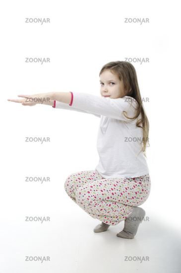 Little girl in nightwear warm-up isolated on white