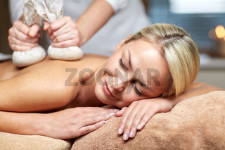 close up of woman lying on massage table in spa