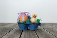 Egg with a little duck in a easter nest.