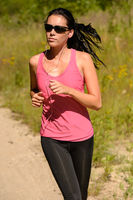 Athlete woman running training on sunny day