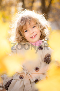 Happy child in autumn park