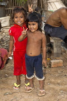 Two local kids making the victory sign, Cambodia