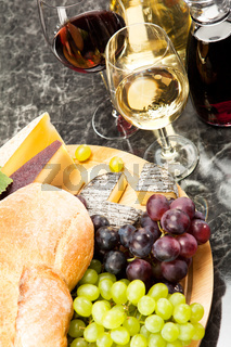 Gourmet food, cheese plate with grapes and bread to wine
