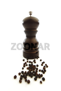 Wooden peppermill with peppercorns