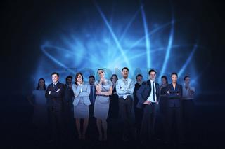 Business team against blue light background