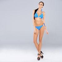 Sexy brunette posing in blue swimsuit