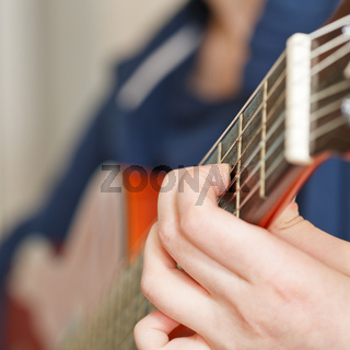 woman playing classical acoustic guitar