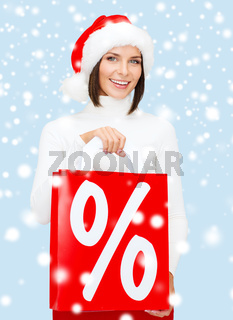 woman in santa helper hat with shopping bags