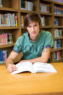 Student sitting in library reading