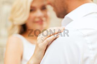 romantic man proposing to beautiful woman