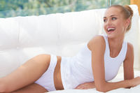 Happy Woman Resting on Couch Wearing Underwear