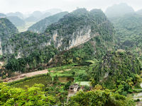 Village among rice fields. Ninh Binh, Vietnam