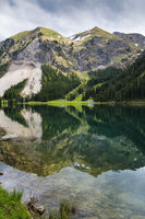 Water reflection of a mountain in a lake, Austria