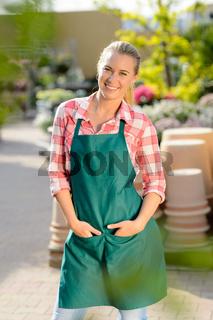Garden center woman worker posing in apron
