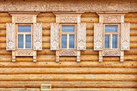 Windows on the wooden house facade. Old Russian country style