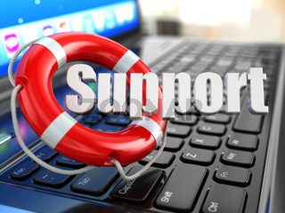 Support. Laptop and lifebuoy on laptop's keyboard.