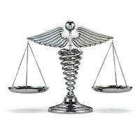 Medicine and justice. Caduceus symbol as scales. Conceptual image.