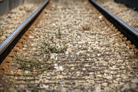 Lower view of train tracks with gravel.