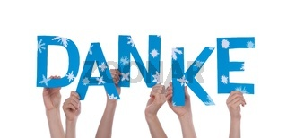 Many Hands Holding the German Word Danke Which Means Thanks