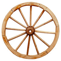Ancient wooden grunge wagon wheel in country style isolated on white background