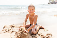 Child boy on sea beach
