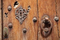 Old wooden door with lock and handle