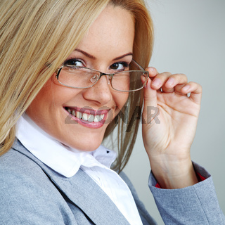 business woman in glasses on gray background