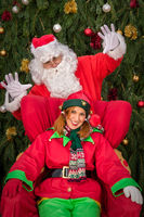 Santa Clause with elf helper Xmas armchair