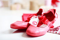 Red shoes with ribbon and heart tag