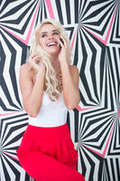 Happy Young Blond Woman Talking Through Phone