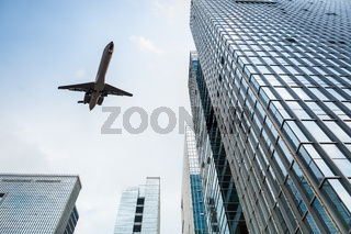 airplane and modern office building