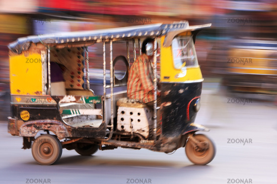 Autorickshaw in the street of Sadar Market, blurre