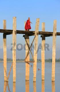 Buddhist monk walking on U Bein bridge, Amarapura, Myanmar