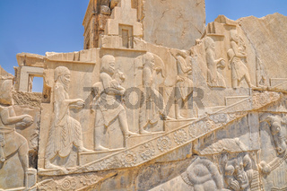 Figures on walls of ancient persian capital Persepolis in current Iran