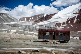 Abandoned trailer in high mountains