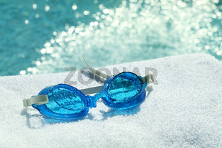 Swimming goggles on towel