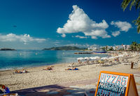 IBIZA, SPAIN- SEPTEMBER 20, 2013: People sunbathing on a Ibiza coast. Spanish island of Ibiza  is famous place which is filled with nightclubs that attracts thousands of tourists a year to party on the island on 20 september, 2013