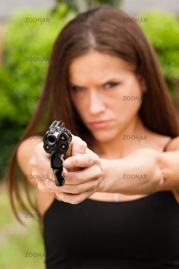Angry Beautiful Brunette Woman Points Loaded Handgun Self Defense