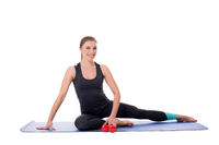 Fitness trainer sitting on mat with dumbbells