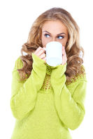 Woman drinking coffee while looking aside