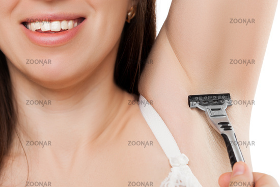 Beauty smiling young woman holding razor blade sha