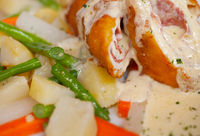 Chicken Cordon Bleu with boiled potatoes and vegetables