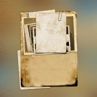 Set of old archival papers and vintage postcard on abstract background
