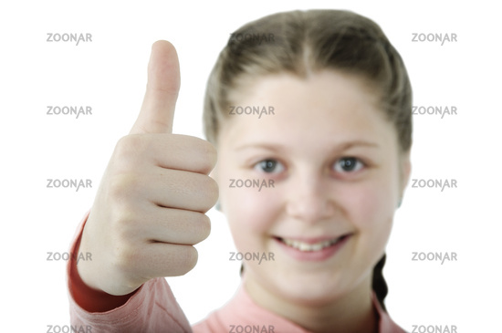 Portrait of pretty little girl showing thumb isolated on white