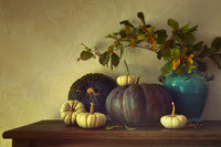 Fall pumpkins and gourds on table with vintage fee