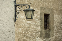 Old street light at a wall, Ticino, Switzerland