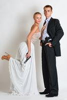 beautiful spy couple in evening dress with a guns.