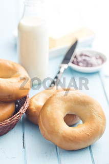 tasty bagels on kitchen table