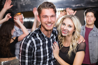 Stylish couple smiling and dancing together