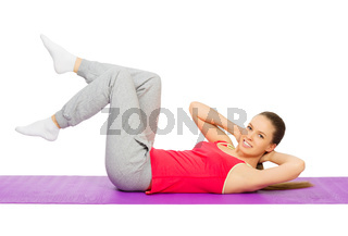 Sporty girl doing gymnastic exercises isolated